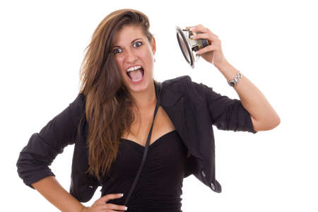 radio active: young business woman with speaker in her hand like loud music