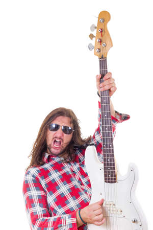 face expression: male musician with face expression in red shirt showing his electric bass guitar Stock Photo