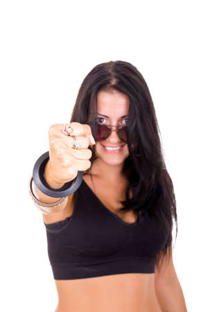 young brunette woman with a fist showing success