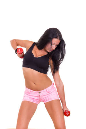 sexy young woman in sports with dumbbells exercising photo