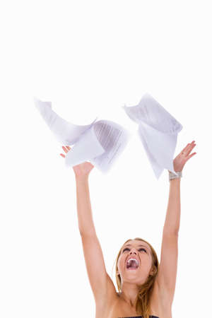 pretty young girl throwing papers in the air photo