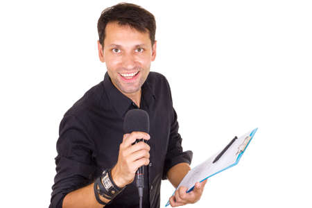 handsome male journalist reporting news on microphone with notes in hand photo