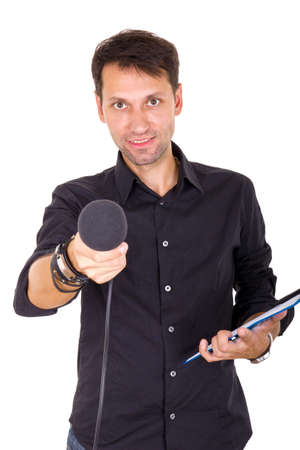 handsome young man doing interview with notes and microphone Stock Photo