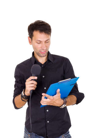 handsome young man giving speech on microphone reading notes photo