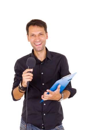 young smiling business man with notes announcing on microphone photo
