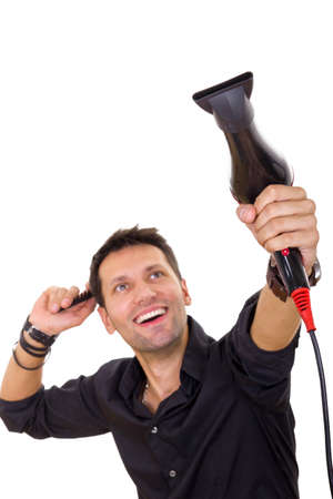 blow drier: attractive smiling hairdresser using blow dryer and comb