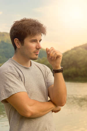 portrait of handsome man at the lake photo