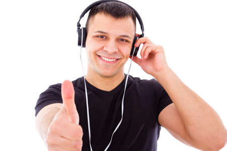 smiling young dj with headphones showing thumbs up photo