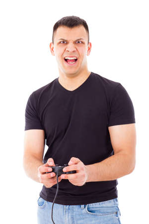 stressed handsome guy losing playing video game with joystick in hands photo