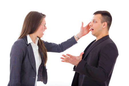 business woman slapping mans face, isolated over white photo