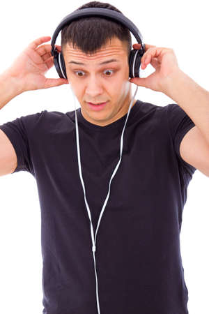 unexpected: man with expression surprised by something unexpected on headphones