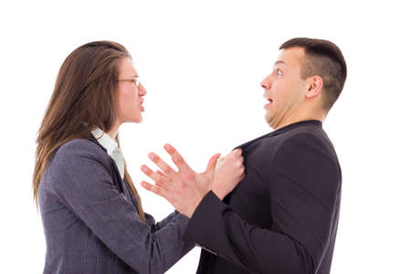Relationship gone bad in the workplace, relationship problems. Young couple quarrelling, shouting. photo
