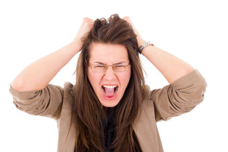 stressed woman pulling her hair in frustration and screaming
