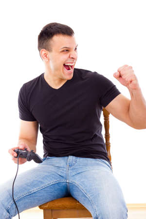 successful man sitting on chair playing computer game with joystick photo