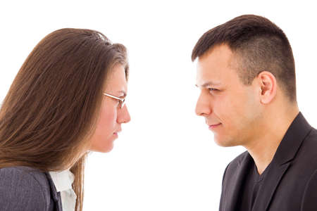 angry young couple in suspicion not trusting each other photo