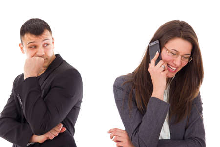 suspicious man looking at his woman talking on the phone smiling photo
