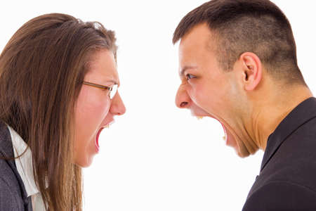 young couple fighting and yelling on each other face to face photo