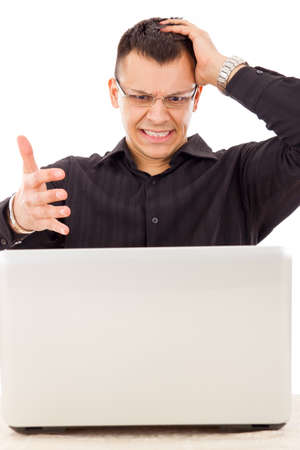 stressed casual man with glasses in black shirt looking at laptop Stock Photo