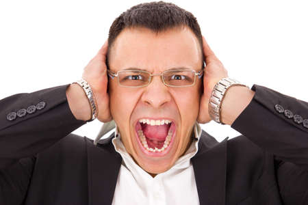 stressed man screaming holding his head with expression photo
