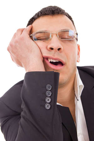 tired man with glasses yawning and sleeping at work Stock Photo