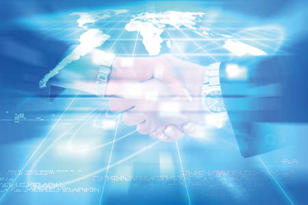 world of connections technology and communication, business handshake between man and woman colleagues photo