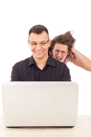 young women spying on men because  infidelity while he chatting over the internet, cyber web infidelity photo