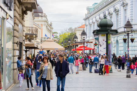 Crowd of anonymous people walking  on the shopping street, main street of Belgrade, Knez Mihailova