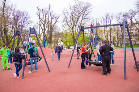 playground in a park full of children and their parents