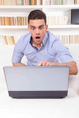 business man looks surprised at content on computer monitor failure, hacked stolen password