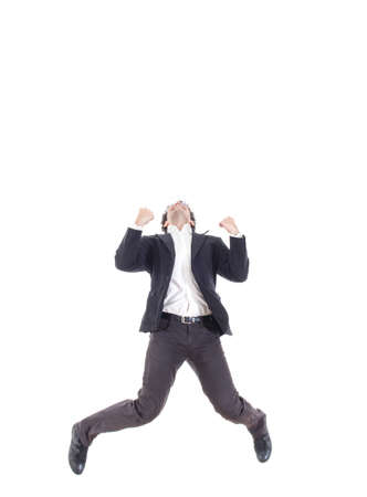 spread legs: Business man jumping of joy and success with legs spread, isolated over a white background Stock Photo