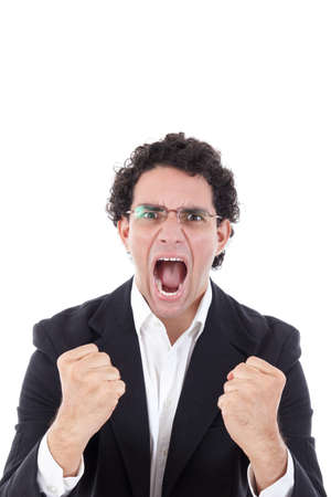 adult man in a suit holding clenched fist and showing sign of success or madness with his hands to the camera with rage face expression, isolated on white background Stock Photo