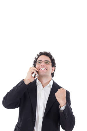 casual adult man in a suit talking on the mobile and shows a sign of success, Isolated at white background photo