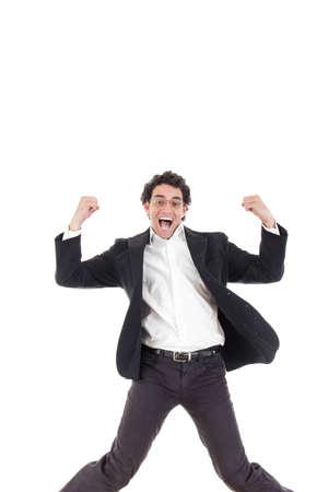 legs spread: Giovane uomo d'affari felice di saltare in aria con le gambe aperte, isolato su sfondo bianco