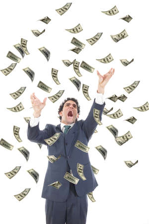 business man catching falling dollars banknotes and screaming, angry stressed man grabbing flying money photo