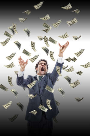 counting money: business man under falling money banknotes screaming reaching for it, dollar rain, stressed man grabbing falling money Stock Photo