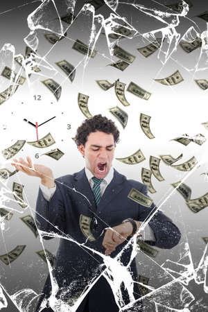 Man behind broken glass measuring time surrounded by falling money, Stressed businessman looking at watch losing money, Time is money concept with financial problems photo