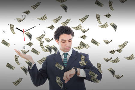 Time is money concept with flying dollars banknotes around businessman, Man looking at watch waiting for money earnings Stock Photo