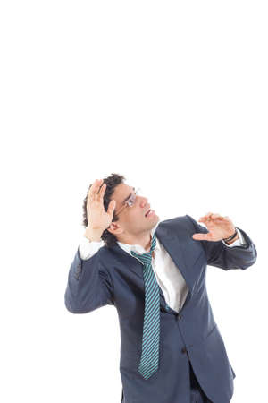 frightened business man looking up, fear of somethnig, mobbing at work from someone, high prices on market