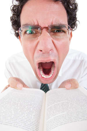 close up of angry nerd in shirt and tie with glasses holding open book, funny image photo