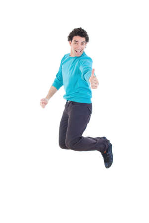 Cheerful young casual man jumping in air showing thumb up smiling, Excited modern handsome man jumping out of joy full of energy like winner photo