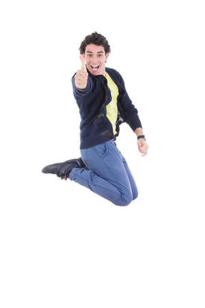 Portrait of young happy expressive caucasian man jumping of joy showing thumbs up against white background photo
