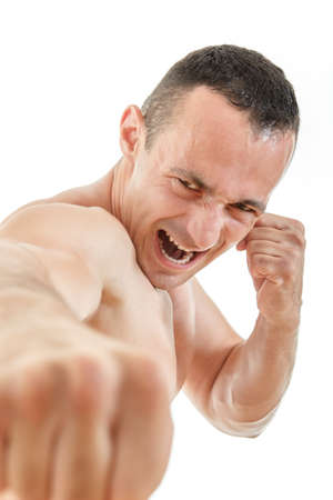 jiu jitsu: Close up portrait of kick boxer fighter punching with determination expression practicing jiu jitsu or thai boxing