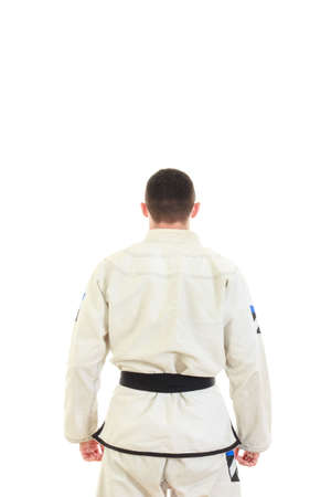 jiu jitsu: Kickbox fighter wearing kimono with black belt in back view, Jiu jitsu karate sportsman with turned back preparing for fight