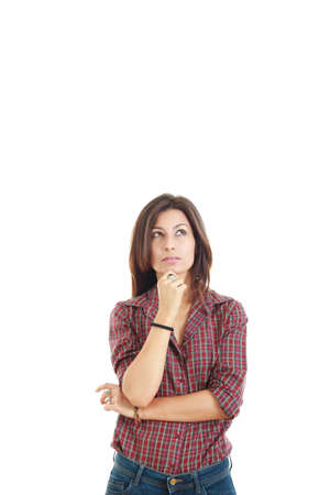 Portrait of the pretty thinking woman having an idea and looking up with lot of blank copy space photo
