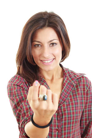 Young beauty woman call with her finger on white background photo