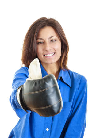 Portrait of beautiful and young business or casual woman wearing boxing gloves and showing thumbs up