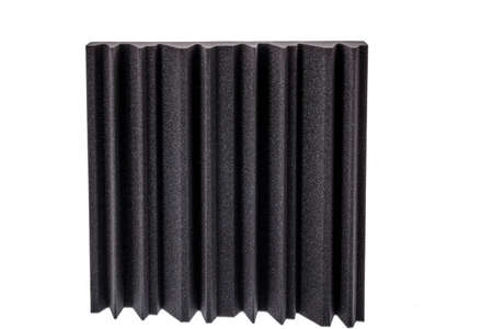 noise isolation: piece of microfiber foam insulation for noise in the corners of the music studio or acoustic halls , rooms or houses , professional studio insulation material , noise isolation
