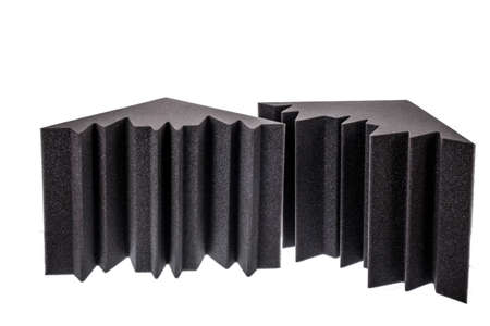 noise isolation: two pieces of microfiber foam insulation for noise in the corners of the music studio or acoustic halls , rooms or houses , professional studio insulation material , noise isolation