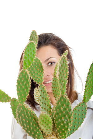 young smiling casual girl or woman with cactus in flowerpot isolated on white background looking through cactus plant , interior decoration photo photo