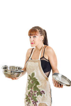 insecure: Insecure girl new in the kitchen with open pot wearing apron shrugging , Modern woman housewife cooking concept